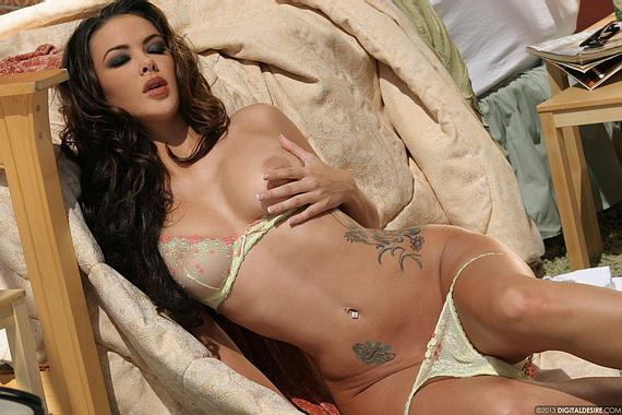 Natalia Cruze undresses in her bedroom